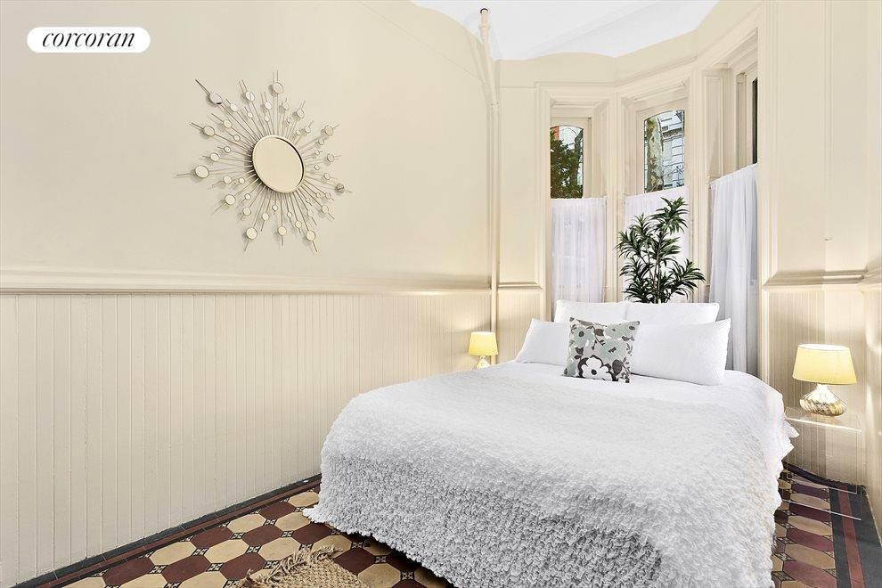Beautiful bedroom with barrel front windows
