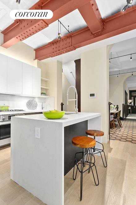 Unique kitchen with custom cabinets & lighting