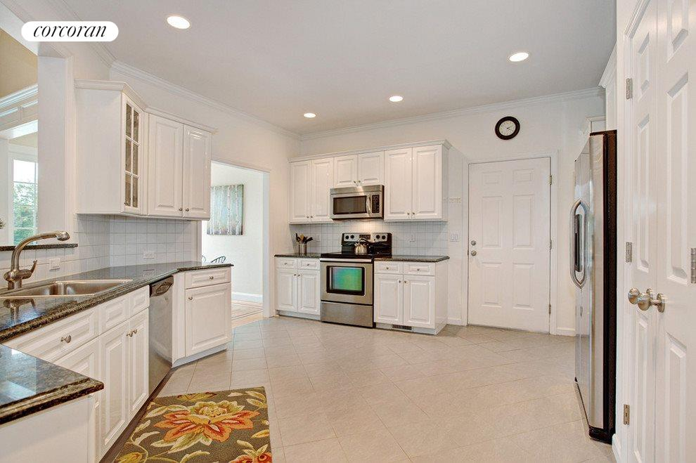 Spacious kitchen with garage access