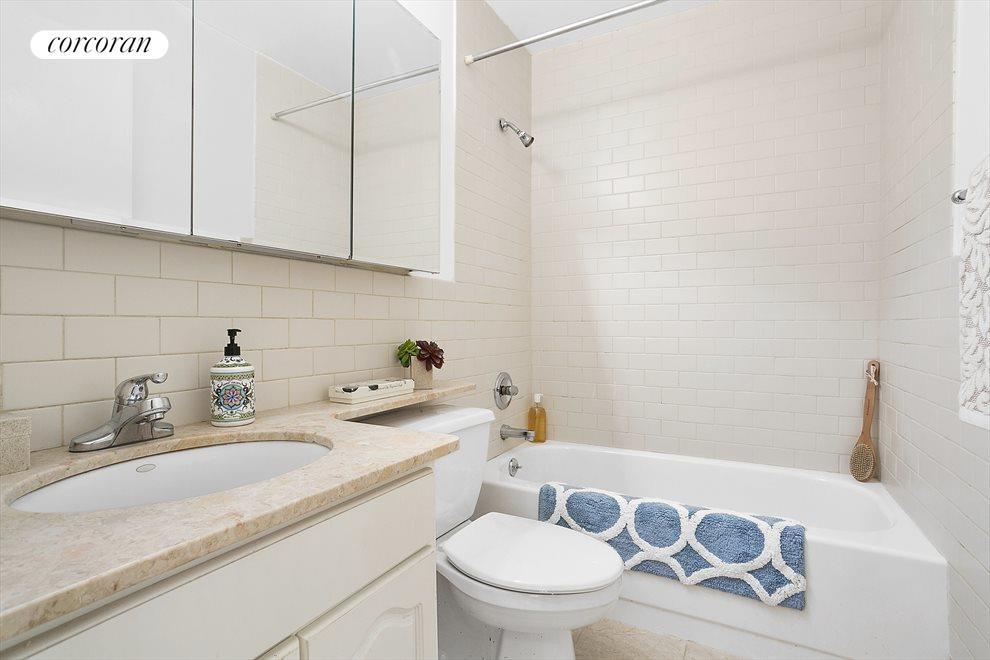 Large tile bathroom with stone banjo top vanity