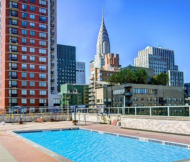 New York City Real Estate | View 300 East 40th Street, #11N | Rooftop pool w/optional membership