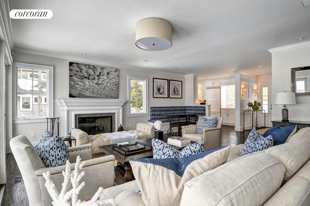 11 Breeze Hill, Light-filled living room with fireplace, access to large deck--all with major water views