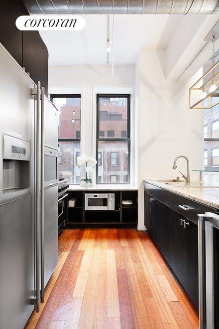 Windowed Chef's Kitchen + Breakfast Bar