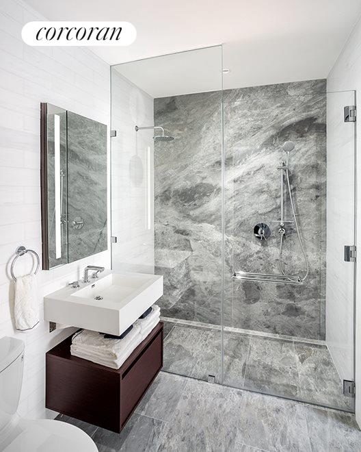 Floor to ceiling marble finished bathroom
