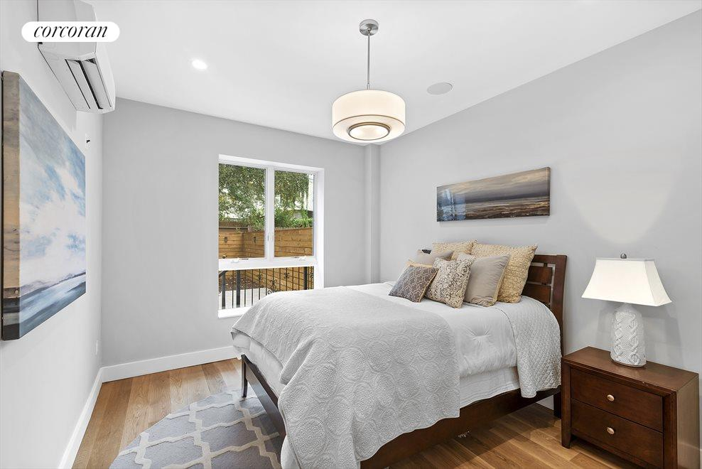 New York City Real Estate | View 139 Grove Street, #1B | King size master bedroom!
