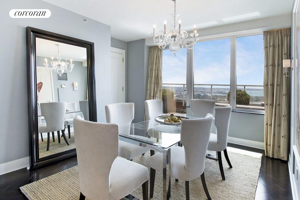 DINING ROOM WITH TERRACE AND RIVER VIEWS