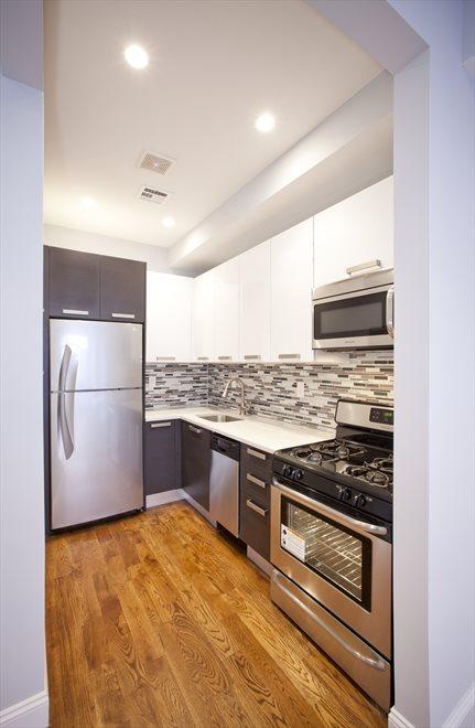 renovated kitchen with tiled backsplace
