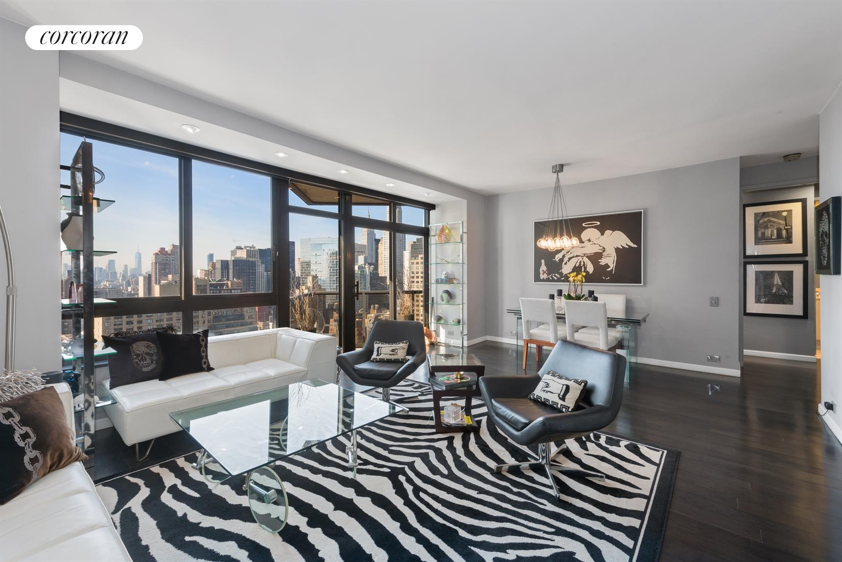 Find out why people love to live at 100 United Nations Plaza!Triple Mint Designer Renovated South facing 2 bedroom 2  bath apartment available for sale at 100 United Nations Plaza - one of Manhattan's premier white glove condominiums. Spectacular Manhattan skyline views from every room of this amazing space that includes the Empire State Building, Chrysler Building, new World Trade center, the East river and much much more.Entertain in style in the living room/dinning room that has a wall of windows, recessed lighting, a custom built in and its own balcony.  Beautiful Wood Floors.  Marble powder room too.Beautifully renovated kitchen with lacquer cabinets and stainless steel appliances.Super large master bedroom suite with a large ensuite marble bathroom that has a Jacuzzi tub and stall shower.  Custom closets galore. The master bedroom has a balcony as well.A split bedroom layout - the second bedroom also has an ensuite bathroom.   9 foot ceilings  oversized windows  two balconies - out of this world views from every room  amazing light - fantastic closet space  beautiful wood floors  split bedroom layout.  Pets Allowed (1 Dog - Maximum weight 50 pounds). Shown by Private Appointment.Located on East 48th Street and First Avenue in Manhattans great Turtle Bay neighborhood - 100 United Nations Plaza has an amazing staff, 24 hour doorman, valet and concierge service, beautiful renovated lobby, on-site management office, renovated meeting room/party room , beautifully landscaped gardens with waterfalls, laundry room, a residents only fitness center and an attached 24 hour attended garage. Conveniently located to transportation and many great restaurants and shops.
