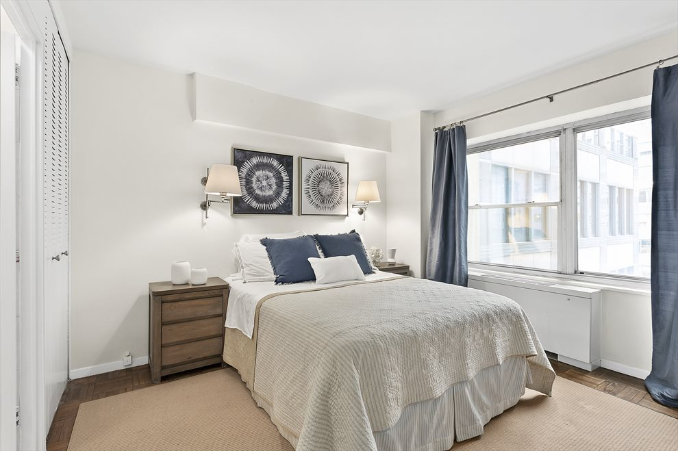 Bedroom with wall-to-wall window