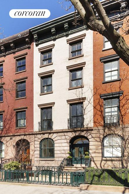 Elegant brick and brownstone facade