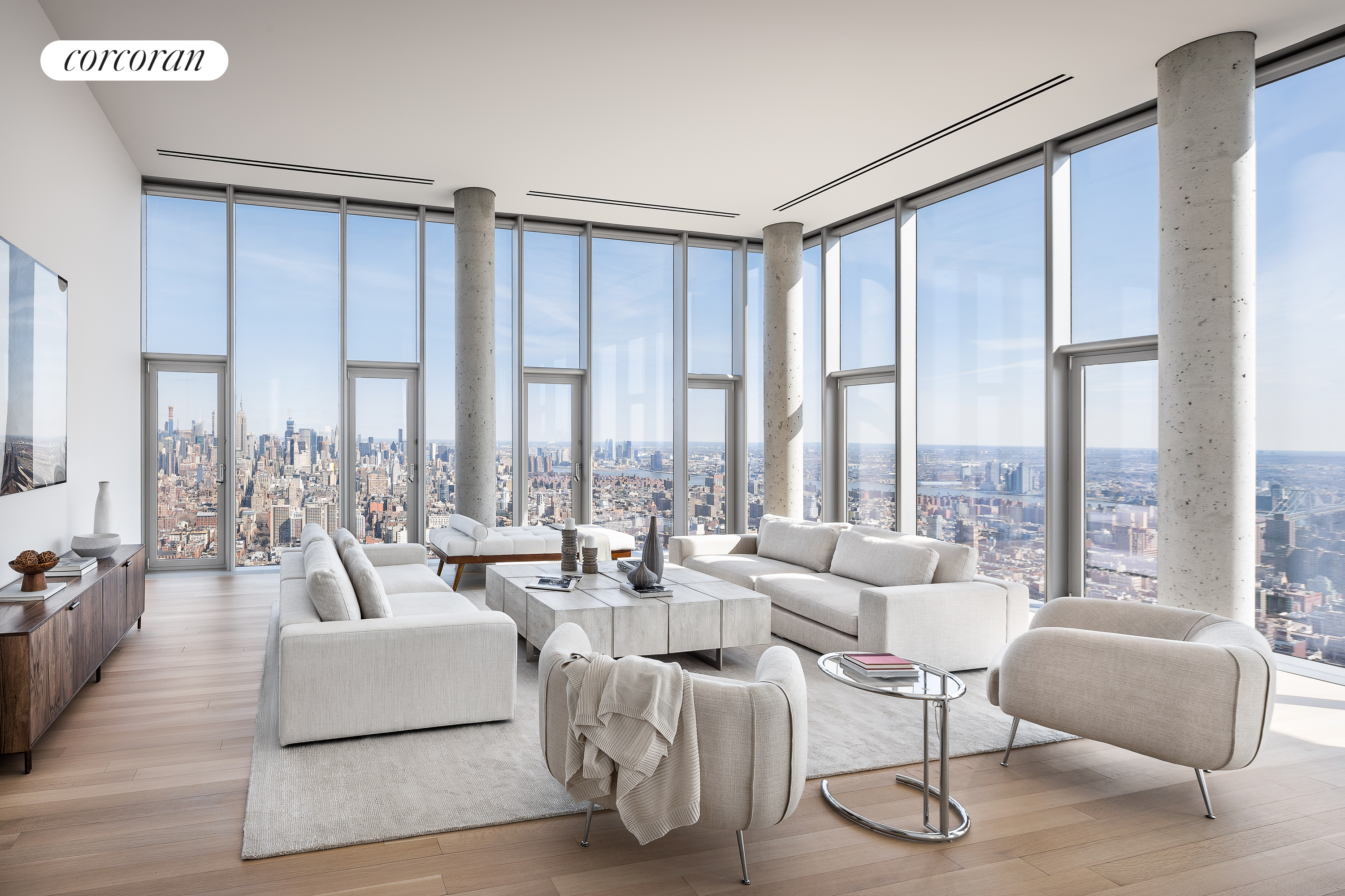 Penthouse 57 is a one-of-a-kind glass villa perched 700 ft in the iconic crown of Herzog & de Meurons 56 Leonard.  Glass window walls and 14 ft ceilings showcase 360 degree helicopter views from river to harbor, bridge to bridge, and to seemingly endless perspectives of the New York skyline. Bathed in light from every direction, this 5,252 square foot, 4-bedroom, 4.5-bathroom home is designed for indoor/outdoor living with 1,763 feet of exterior space.Direct elevator entry opens in to a formal gallery and onto the custom interiors designed by Pritzker Prize-winning architects Herzog & de Meuron. Vast entertaining spaces flow naturally from formal great room to library, den, dining room, and kitchen. A custom designed free-standing wood-burning fireplace with Venetian plaster creates a dramatic focal point.  From a magnificent single centerpoint in the gallery, there are direct sightlines spanning all four directions. The set-back open kitchen features a sculptural Absolute Black granite grand piano shaped island with a custom-sculpted floating hood. The chefs kitchen boasts integrated appliances including double Sub-Zero refrigerators, Miele double ovens, six-burner cook top with fully-vented hood, two dishwashers and Sub-Zero wine cooler. Satin-etched glass Molteni cabinets provide abundant storage and subtly take on the changing tones of the sky. The corner master bedroom suite with Hudson River facing balcony, large dressing room, and an oversized, windowed five-fixture master bathroom of travertine and Thassoss marble, with radiant heated floors, steam shower and dual shower heads and a freestanding soaking tub with a dramatic backdrop of the NYC skyline. Three additional corner bedroom suites with en-suite baths. The powder room has a striking vanity carved from a single block of Travertine into a smooth, softly curved basin; above is a custom mirror with lighting by Herzog & de Meuron. Appalachian solid White Oak flooring throughout, 4-pipe heating and cooling system for year-round multi-zone climate control, fully vented laundry room, cedar closet, and dedicated service entrance allow for effortless living.  56 Leonard boasts 17,000 square feet of amenities including a 75 lap pool with a sundeck, steam room, redwood sauna, hot tub, gym, screening room, lounge, private dining room and playroom. 56 Leonard is a beloved global landmark that has left an indelible mark on the New York skyline. In late spring 2019, Artist Anish Kapoor will install his first permanent work in New York at the base of 56 Leonard, solidifying this unprecedented collaboration between artist and architect. 56 Leonard offers on-site parking and storage for purchase. Penthouse 57 is a Sponsor residence with no board approval. 421A Tax Abatement.Exclusive Marketing & Sales Agent: Corcoran Sunshine Marketing Group