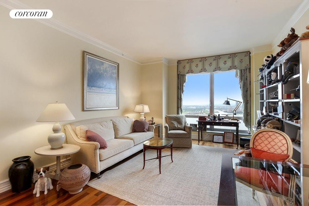 New York City Real Estate | View 30 West Street, #PH2G | Living Room with Direct River Views