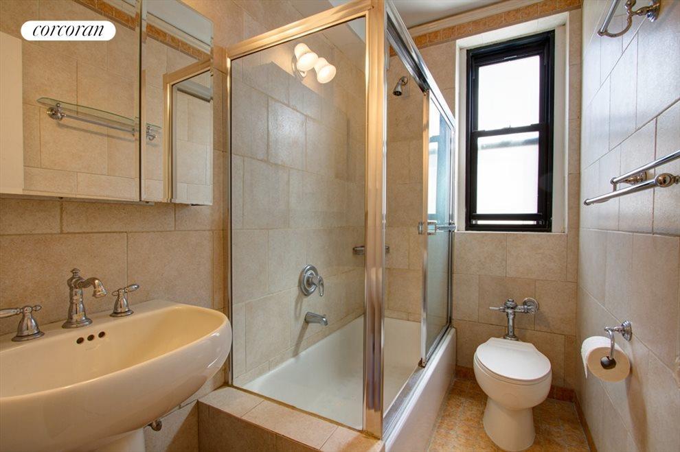 Windowed bathroom with glass enclosed tub/shower