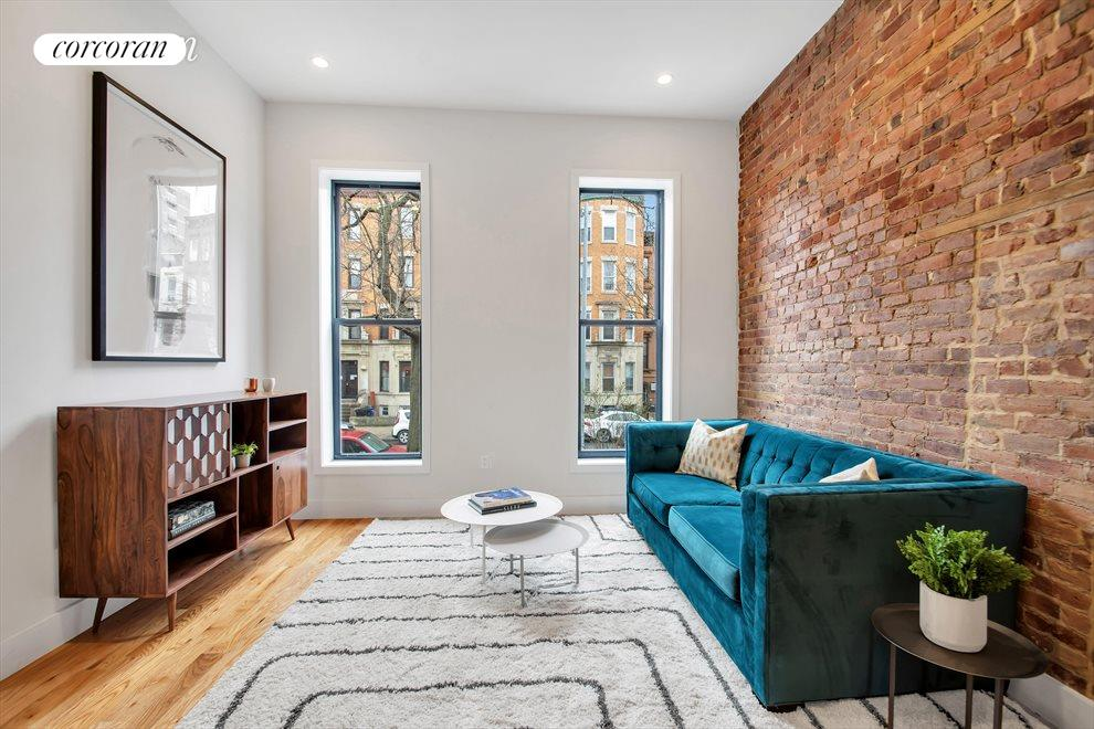 Charming Living Area w/ Over-sized Windows