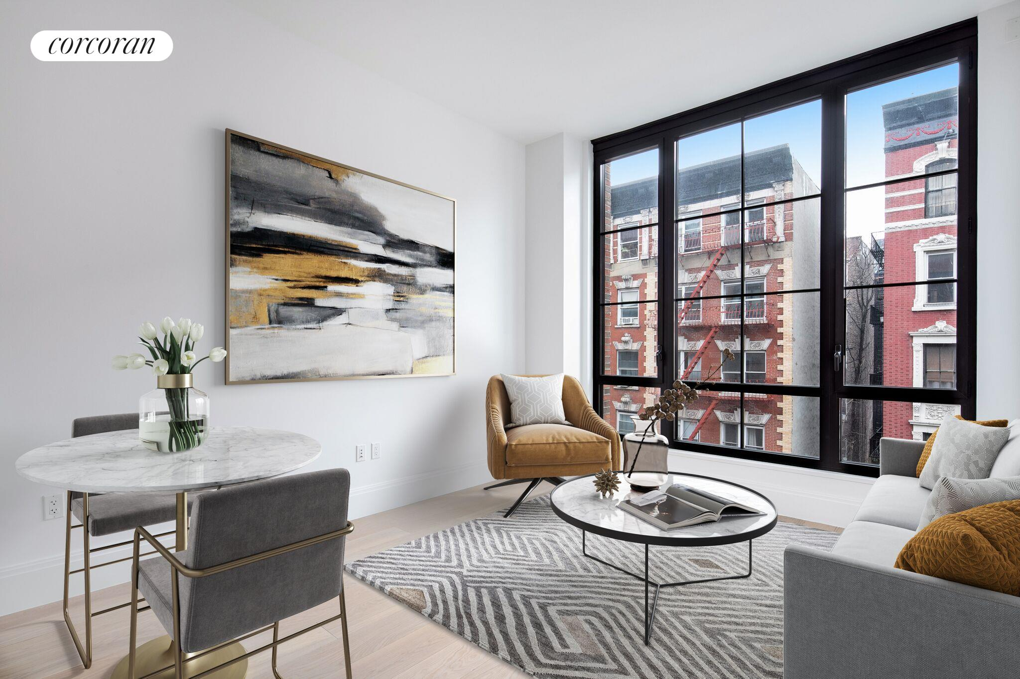 This lux full-service condominium in the heart of the East Village offers a rare modern retreat in this historic neighborhood. Featuring North and East exposures, this corner 1 bedroom/1 bathroom + home office offers soaring 107 ceilings and 744 square feet of sunlit space.The living room and kitchen feature an open concept layout, which is highlighted by the oversized casement windows framed in statuary bronze. The open concept kitchen with an eat-in island offers ample counter space for cooking and dining. The kitchen has been meticulously designed by Paris Forino with top-of-the-line finishes including Satin lacquer custom Italian cabinetry, limestone and Calacatta marble countertops, and blackened metal hardware. Featuring top-of-the-line appliances by Wolf, Bosch, and Sub-Zero including wine storage, full gas range with hood, built-in microwave, dishwasher, as well a hidden washer/dryer. Floor to ceiling cabinet space provide abundant storage for even the most avid cook.The Master bedroom creates a serene sanctuary above the ever-evolving streets of the EastVillage, looking out onto the charming historic village buildings. The oversized floor to ceiling casement windows open up the room and envelop it in natural light. The roomy French door closet makes generous space for storage, with an additional closet in the home office.The en-suite master bath features sleek black and white tiled finishes including Bianco Carrara honed mosaic floors and a custom-cerused white oak vanity and a Bianco Dolomiti countertop, with Waterworks chrome fittings throughout. The extra-large vanity provides plentiful storage along with a full-length mirror which opens up to reveal hidden recessed shelving.The Steiner East Village, a collaboration between Paris Forino Interior Design with architecture by S9 Architects and landscape architecture by Future Green Studio, provides an extraordinarily unique living experience in one of Manhattans most culturally rich neighborhoods.This full-
