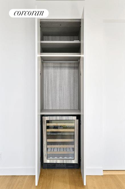 Storage closet and wine fridge