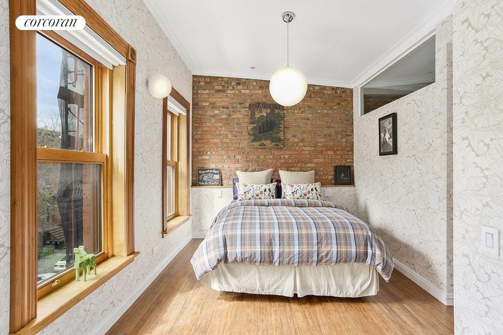Exposed brick in one of 4 bedrooms