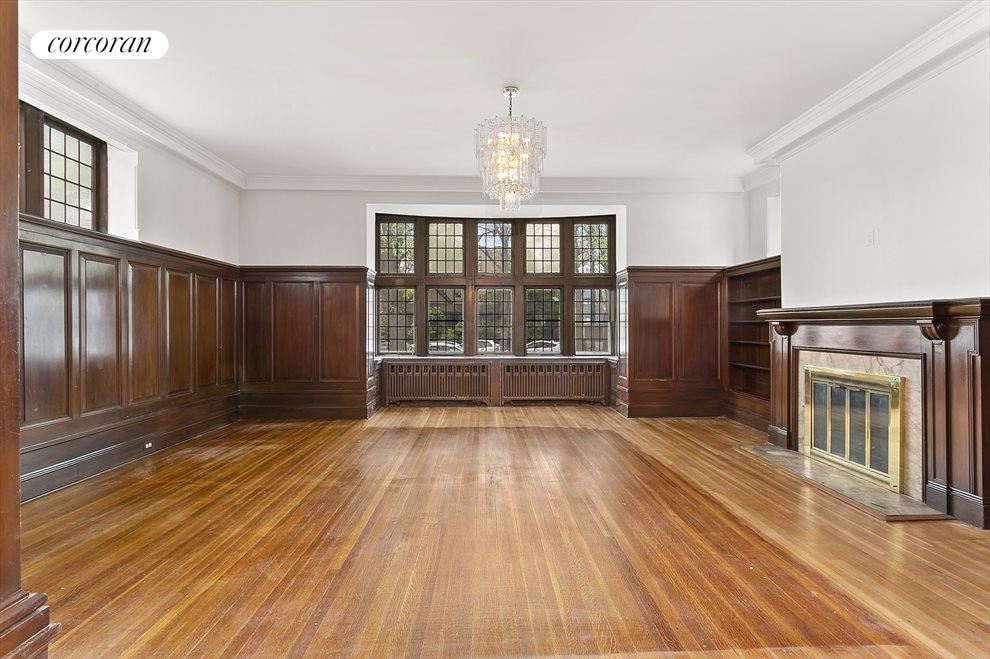 The paneled Great Room with original fireplace