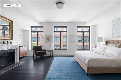 New York City Real Estate | View 141 West 11th Street | Master bedroom with wood burning fireplace
