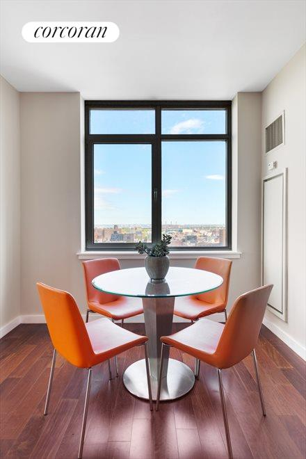 Windowed dining area can fit a table for eight