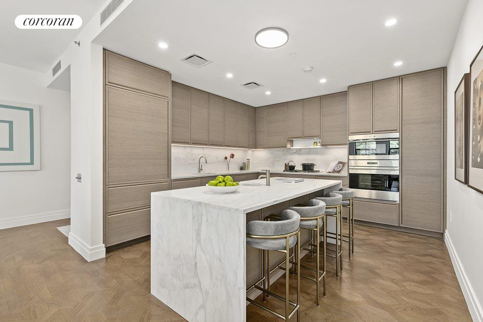 eat-in kitchen with over sized marble island