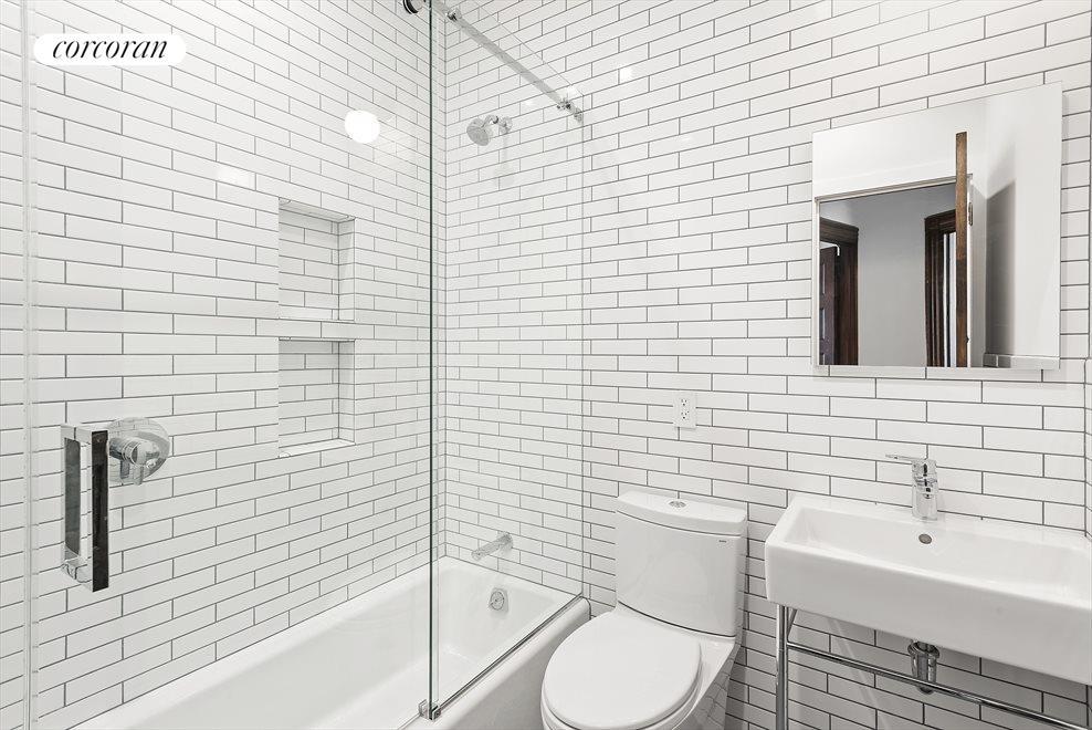 Similar Listing Bathroom also features a skylight