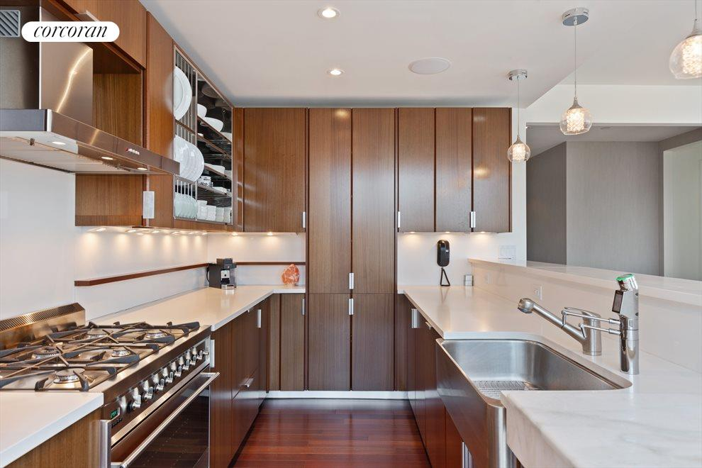 Teak cabinets with matching  paneled appliances