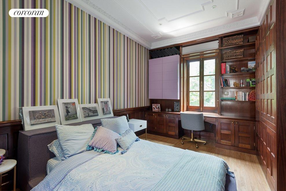 Large, Charming Bedroom with Wood Paneling