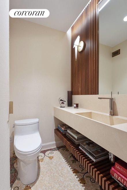 Powder Room with Mosaic Tiling