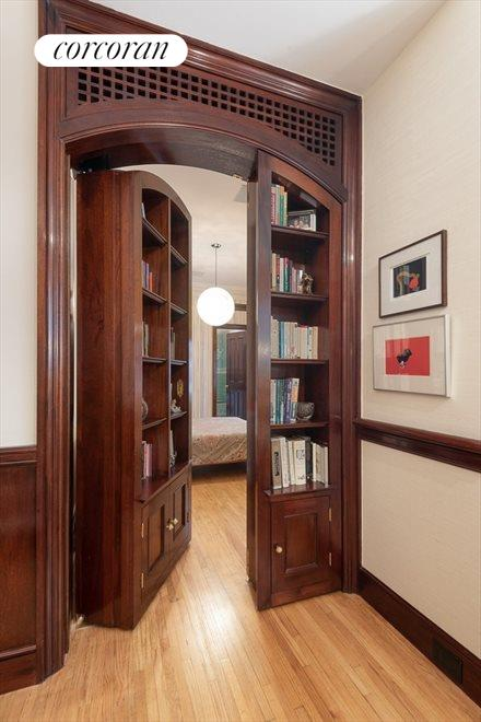 Wood Paneled Doors Lead to Hidden Bedroom