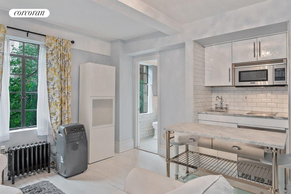 New York City Real Estate | View 45 Tudor City Place, #305 | Kitchen / Living Room