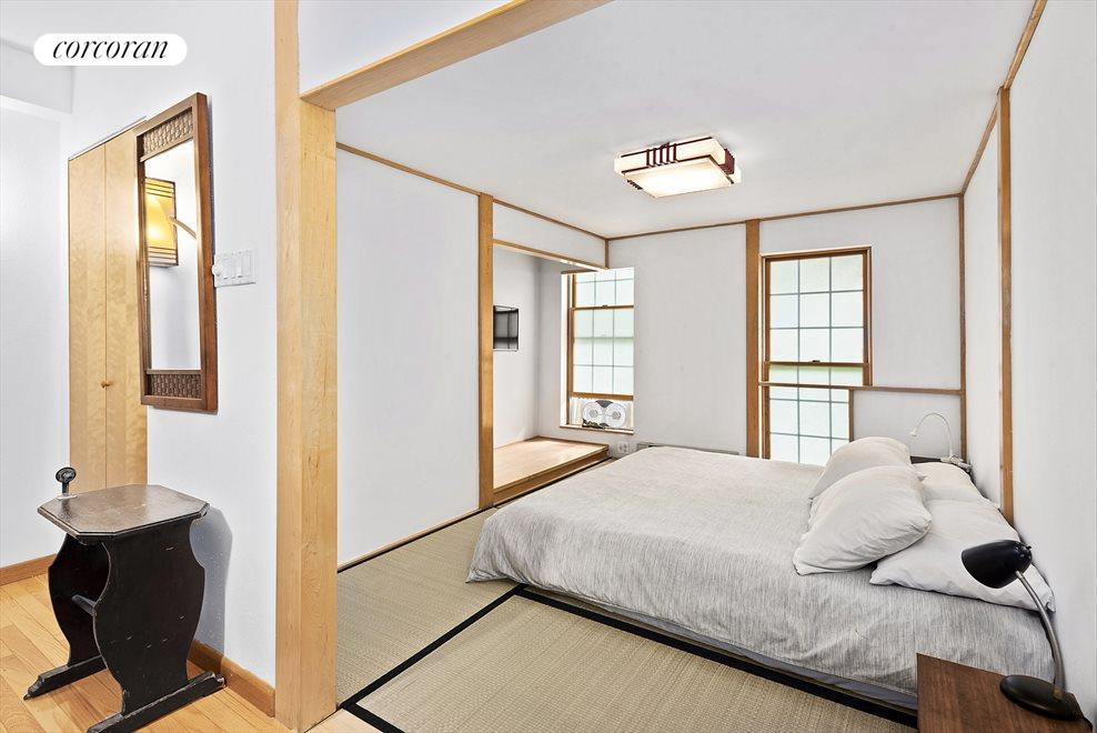 Eastern-style serene bedroom with tatami mat