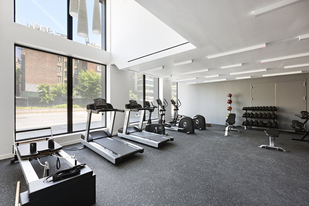 Bright, windowed fully equipped fitness room