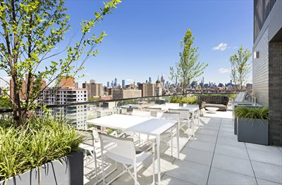 New York City Real Estate | View 287 EAST HOUSTON ST, #5C | Common Terrace with outdoor kitchen