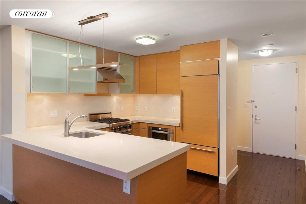 Kitchen with high-end appliances and wine fridge