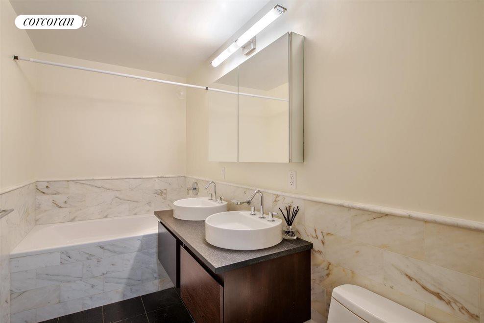 En suite master bathroom with steam shower