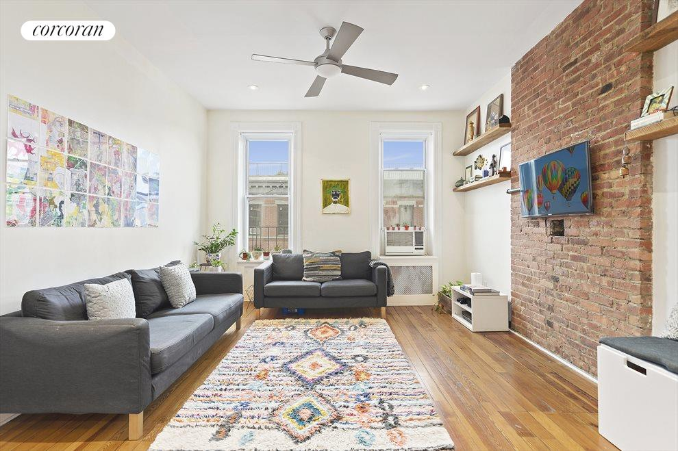 Bright and Open Living Room w/ Exposed Brick