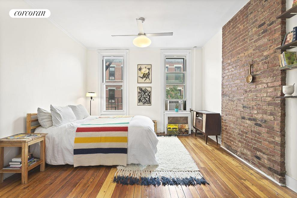Large Master w/ High Ceilings and Exposed Brick