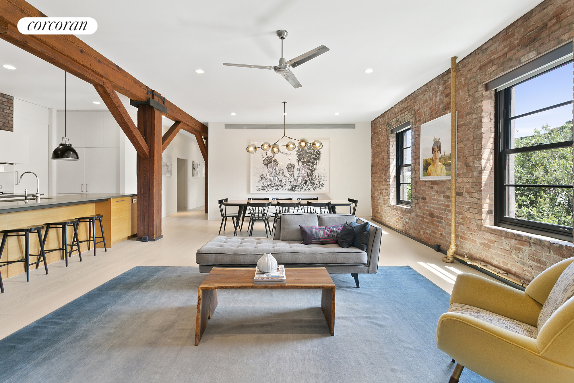 West Village loft living is yours in this gorgeous three-bedroom, three-bathroom home combining original architectural details, recent renovations, great light, and substantial storage in a supremely enviable location.Encircled by 13 oversized windows on three exposures, the sprawling 2,500-square-foot layout basks in lovely sunlight and neighborhood views throughout. Exposed beams, brick, and high ceilings nod to the loft's turn-of-the-century origins, while new hardwood floors and other modern updates make it a sanctuary of contemporary living.The key-locked elevator delivers you to the sweeping corner great room featuring southern and western exposures and Henrybuilt custom shelving. Generous proportions provide plenty of room for living and dining areas. Set between the home's dramatic beams, the gourmet open kitchen, also by Henrybuilt, features basaltina countertops and appliances by Viking, Miele, and Sub-Zero. The massive island/breakfast bar provides casual dining for five. Modern recessed lighting runs throughout. Enjoy treetop serenity in the master suite where a room-size walk-in closet, three more closets, and a wall of drawers attend to storage. An en suite bathroom features a lavish rain shower, steam shower, and double vanity. Two additional bedrooms have easy access to two more full baths across the hall. Several more closets, modern central air, and a large laundry room with a vented washer-dryer and utility sink round out this comfortable and beautiful home. The layout and numerous exposures could accommodate a fourth bedroom if desired. Built in 1909, this charming brick warehouse is a boutique, pet-friendly co-op offering the unit an additional 50-square-foot private/locked basement storage room, a bike room and a common roof deck with a grill and expansive city views. Set in a quiet spot in the Greenwich Village Historic District, the best of West Village shopping, dining, and nightlife are steps away. Hudson River Park's hundreds of acres of w