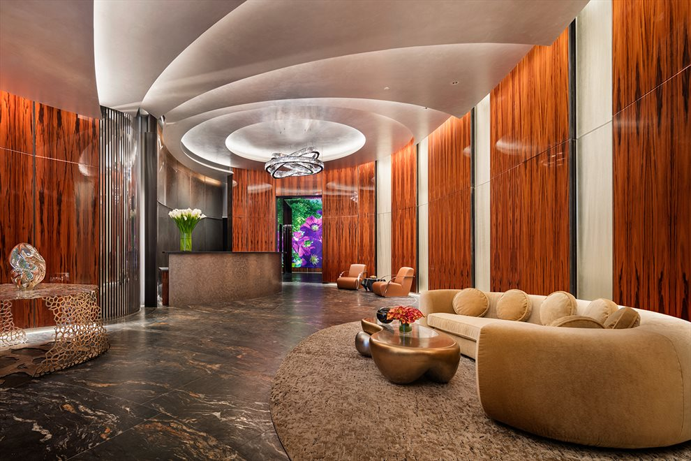 The lobby is finished in opulent woods and marbles