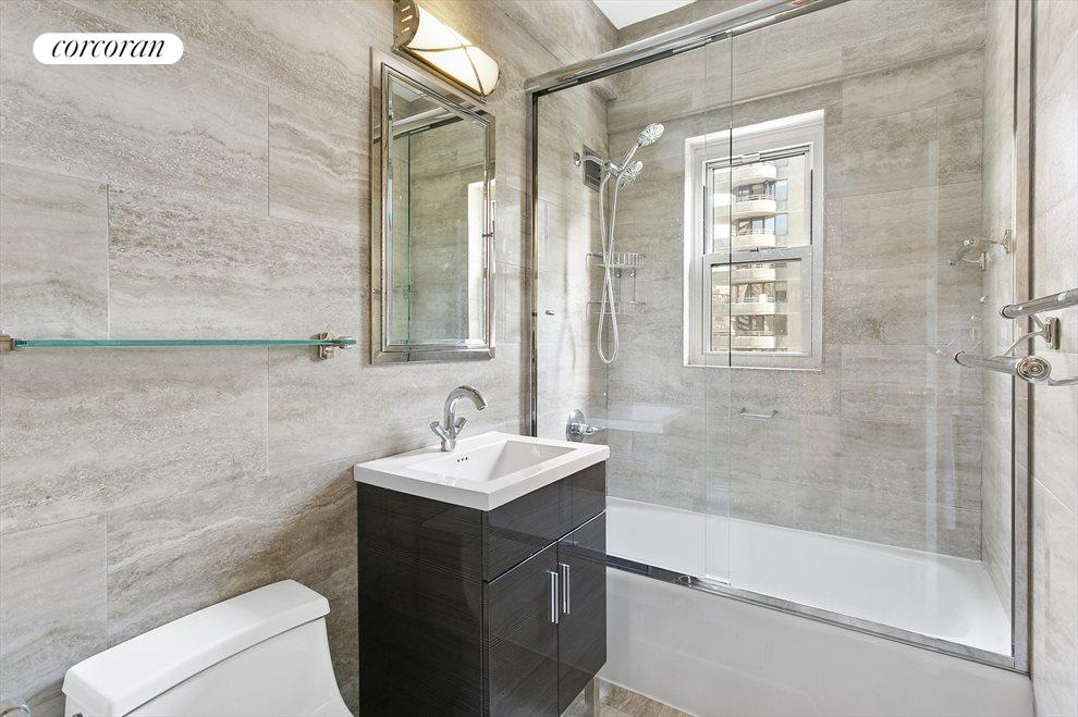 New York City Real Estate | View 301 East 48th Street, #15J | Renovated and windowed bathroom