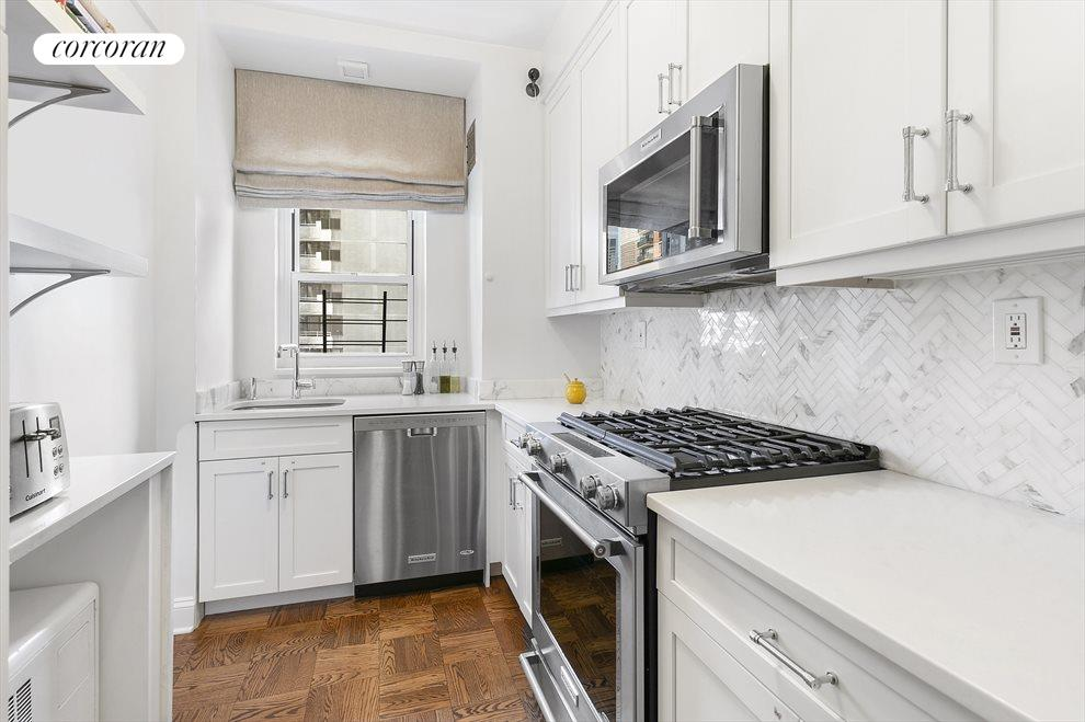 New York City Real Estate | View 301 East 48th Street, #15J | Renovated chef's kitchen with stunning countertops