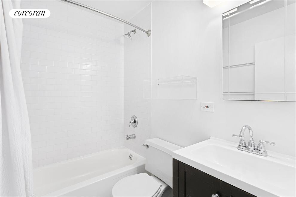 White-on-white renovated Bathroom.