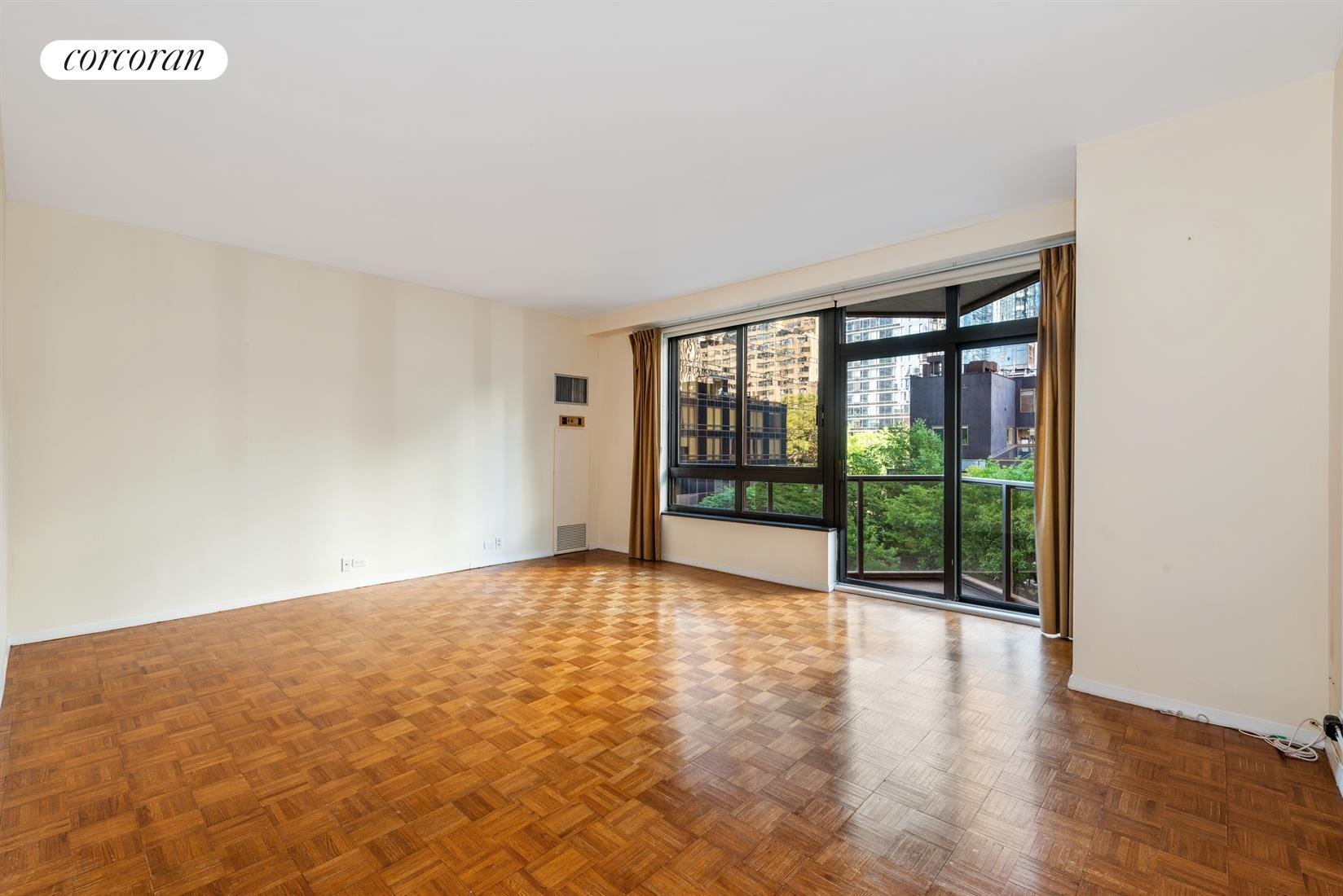 Sunlit and spacious 1 bedroom with private balcony for rent at 100 United Nations Plaza.This south-facing unit has a great layout and offers 9' ceilings, oversized windows, great light and a balcony off of the living room. The large living room will comfortably accommodate separate living and dining areas and enjoys lush treetop and city views. The galley kitchen has clean off white cabinetry and countertops, ceramic tile flooring and full size appliances including a dishwasher, Sub-Zero fridge, built-in microwave and gas range. The king-size bedroom has a large closet and the marble bathroom features a Jacuzzi bathtub. Located on East 48th Street and First Avenue, 100 United Nations Plaza is a white-glove, full service condominium in Manhattan's Turtle Bay neighborhood. Greeting residents with beautifully landscaped gardens and waterfalls, this impeccably run building offers a 24-hour doorman, valet and concierge service, on-site management office, renovated lobby and resident's lounge, common laundry room, fitness center and direct access to a 24-hour attended parking garage. Conveniently located to transportation and many great shops and restaurants. Showing by appointment only. Some images have been virtually enhanced.