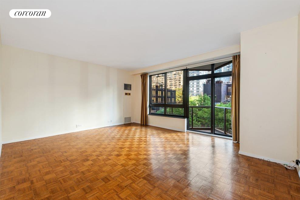 South-facing living room with balcony