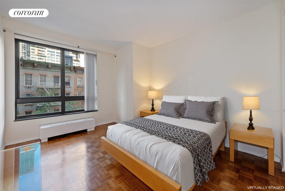 Large bedroom with oversized windows, virtually en