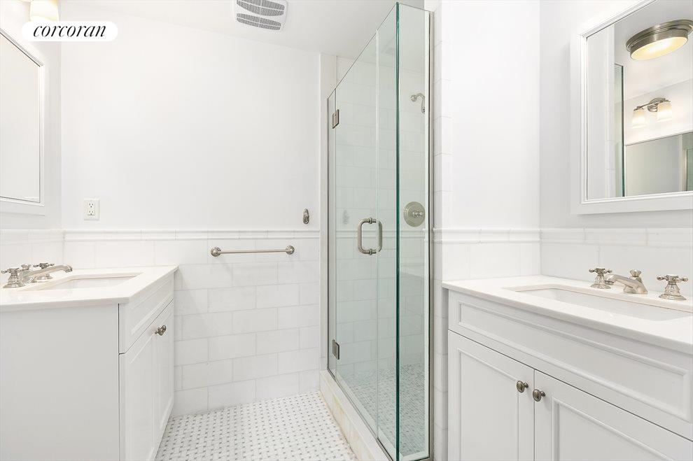 Master Bathroom with dual sinks and glass shower