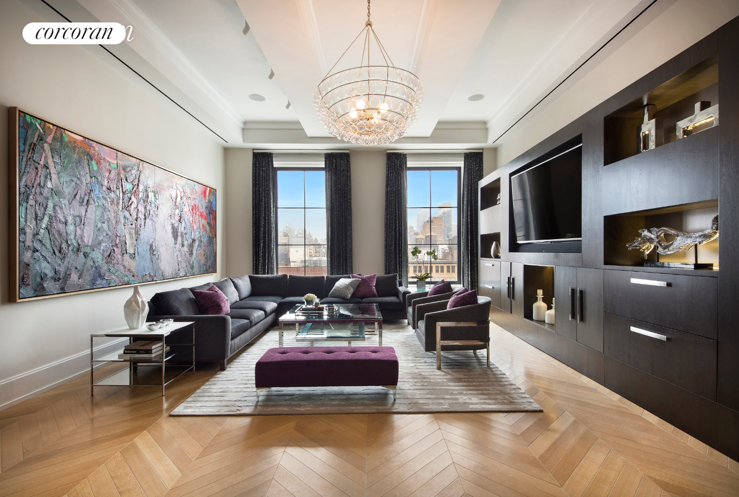 An exquisite and spacious four-bedroom, four-and-a-half-bath residence with two master suites, custom designed with premium upgrades in Chelsea's Walker Tower.Oversized tilt-and-turn windows in every room of this almost 3,900 SF corner home with views facing South, West and North. French herringbone oak flooring and up to 12 ft ceilings set an elegant tone throughout. Enjoy loft-like proportions in the massive great room lined with a wall of custom built-ins, while the Smallbone kitchen features marble and limestone countertops, Dornbracht fixtures, Sub-Zero refrigerator, fully vented induction cooktop with pot filler, two Viking wall ovens and a warming drawer, Miele speed oven and built-in coffee system, and a wine refrigerator.The sprawling master suite is a serene escape with grand dimensions. The en suite bathroom in floor-to-ceiling marble, features an inviting cast-iron soaking tub, frameless glass steam shower, extra-wide dual-sink vanity and Waterworks fixtures. A glamorous dressing room is flanked by two walk-in closets, with three additional closets providing even more storage. Three more complete bedroom suites line the western wing of the home, each with elegant wall-coverings, chic custom lighting, walk-in closets and gorgeous en suite bathrooms. No detail was overlooked in the design of this home. Radiant heat floors pave the entire residence; a Crestron Home Automation System attends to all controls; the large laundry closet features a fully vented dryer; and built-in zoned humidification system, ultra-quiet central air conditioning and ventilation ensures optimal temperature and air quality year-round.Designed by Ralph Thomas Walker, the building was originally built in 1929 and then converted to luxury condominium homes in 2012. Residents of Walker Tower enjoy 24-hour doorman and concierge service, a library lounge, state-of-the-art fitness center, playroom and a landscaped roof deck with dining area, sun lawn, observation area and covered cabana. 
