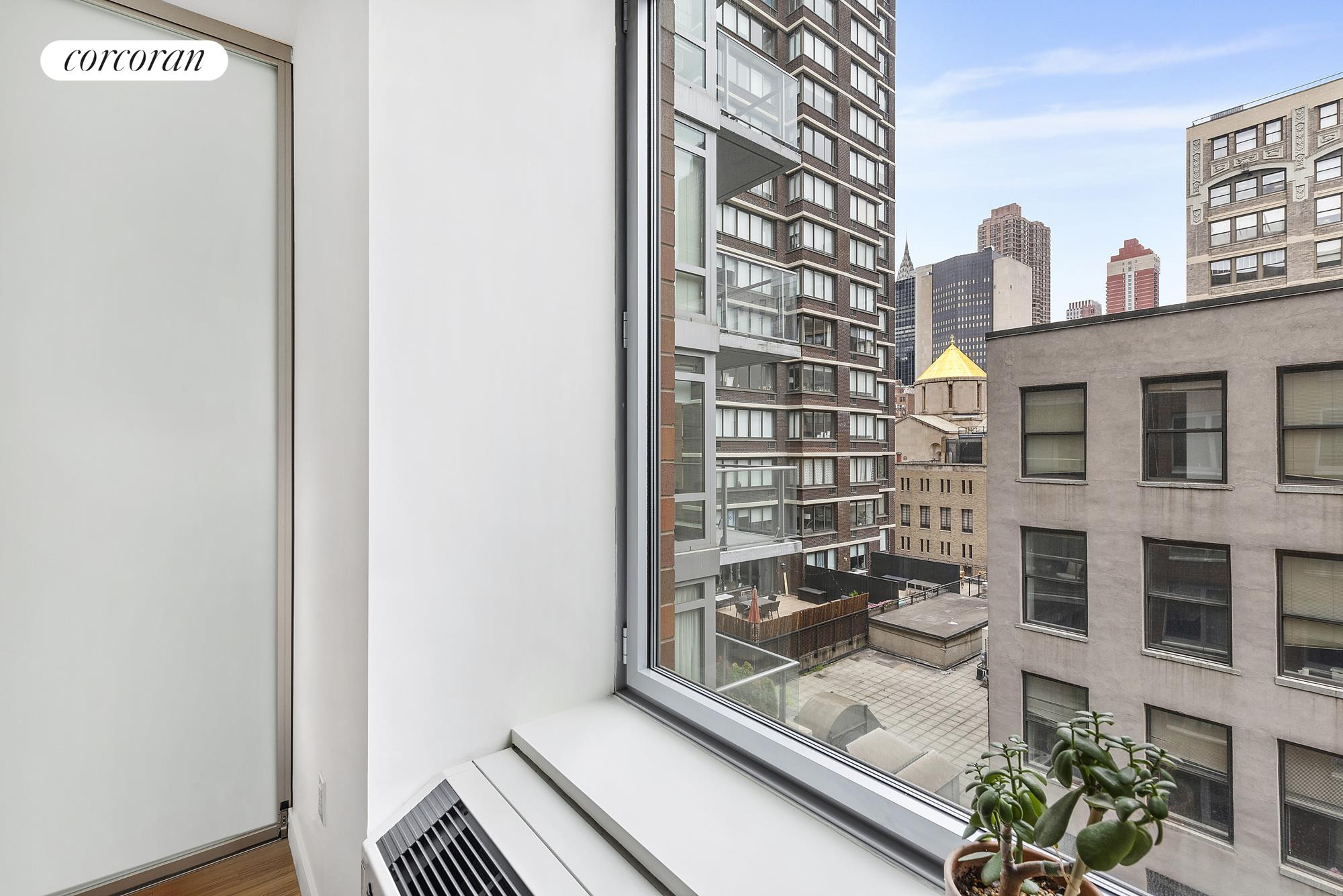 303 East 33rd Street, 6D, Loft-Like Living Room with Sliders