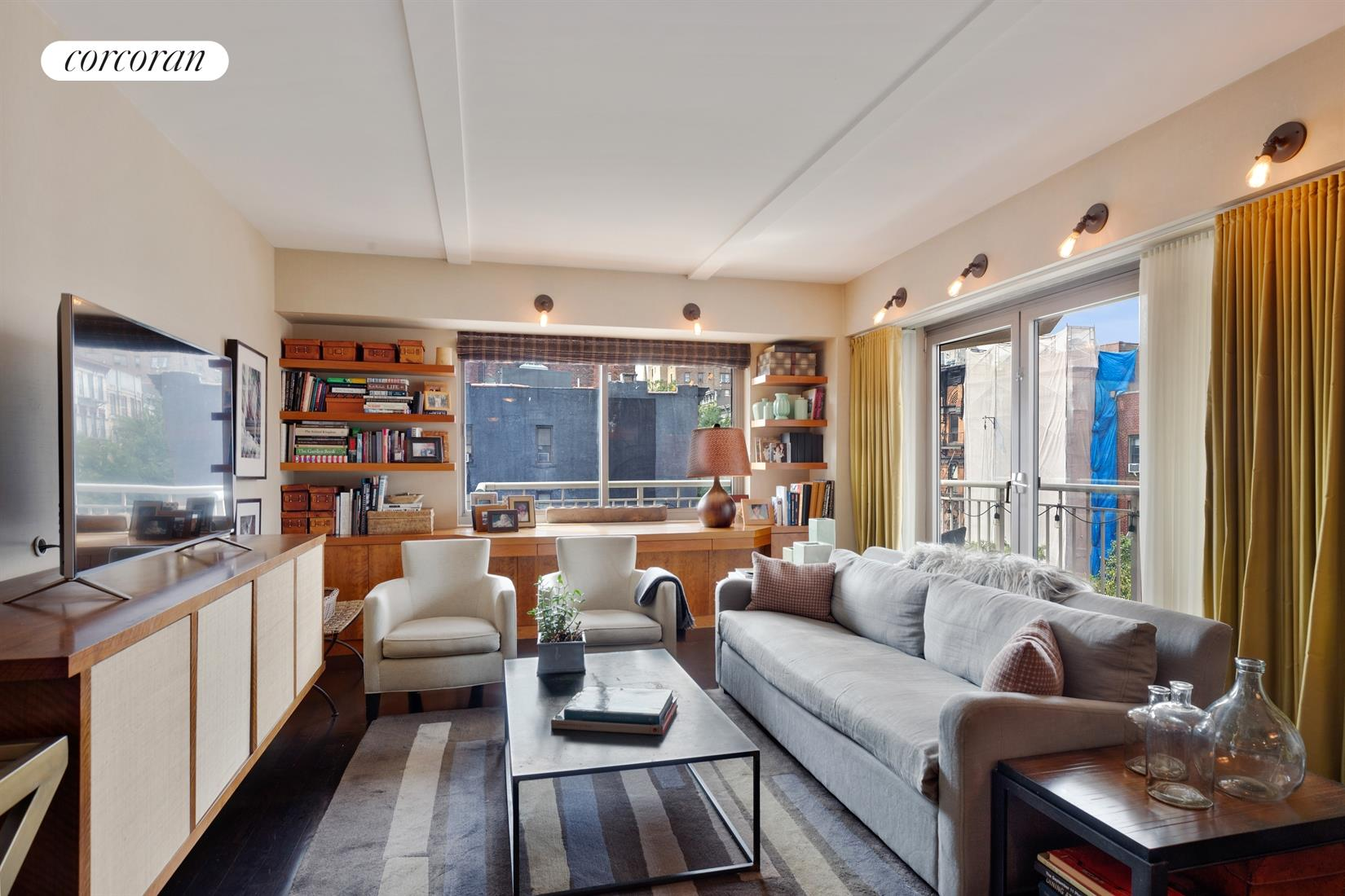 Outdoor living!  Spacious 2BR/2BTH with huge wrap terrace in the sought after New Theater Condominium with full time Doorman! Located in the heart of the East Village on a quiet tree-lined block, this home has brilliant light and open views from all rooms.  The sprawling layout includes a large entry foyer with built-in storage bench, Washer/Dryer, a state of the art designed open kitchen with honed black granite counters, a custom built-in banquette to create a dining area, and a gracious separate bedroom wing. The corner living room faces west and north with over-sized windows and access to the terrace to enjoy morning coffee or evening cocktails!  The master bedroom easily fits a king-sized bed, has a built out walk-in closet and an elegant en suite bathroom.  The apartment has been outfitted with smartly designed storage throughout.Three exposures provide light all day and is pin drop quiet.  This rarely available line feels like a country house with indoor/outdoor living coupled with a modern stylish aesthetic.  The New Theatre Condominium is pet friendly, has a full time doorman and super, a recently renovated sleek lobby and is surrounded by top restaurants, charming cafes and shops, Tompkins Sq park, and all transportation.  Make this one of a kind home yours!  Also available for rent $7,500 per month
